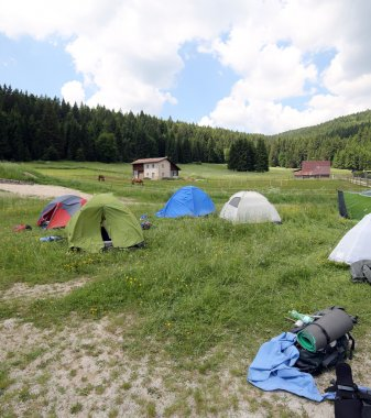 dome tents in the mountains during a campsite of boyscouts