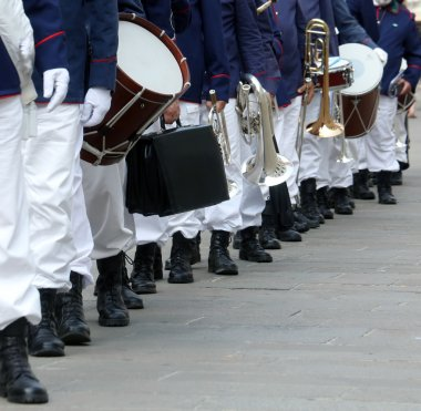 Parade of musicians of the band in full uniform on the town stre