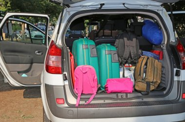Suitcases and luggage in family car