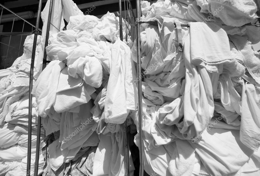 dirty laundry in the industrial laundry before washing