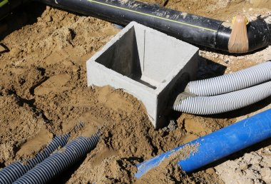 corrugated pipes for electrical cables and a cockpit in concrete