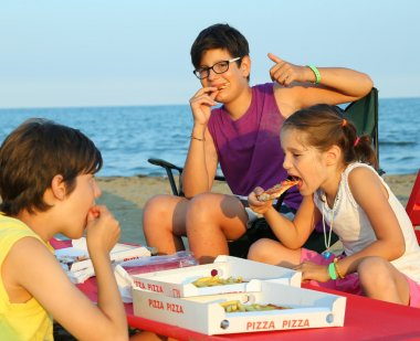 happy three brothers eating pizza