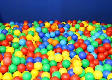 gym in the kindergarten with many colored plastic balls