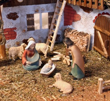 Classic nativity scene with baby Jesus Mary and Joseph in the ma