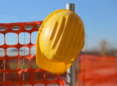 hard hat on the road construction site during road works and a s