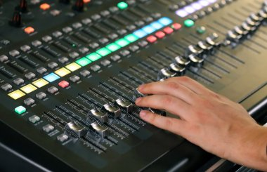 big mixing console with channel to change volume and bass and tr