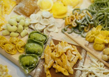 green and yellow tortellini with eggs and flour and spinach