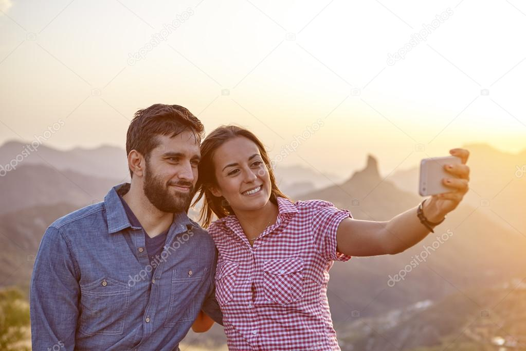 Young couple on mountain top