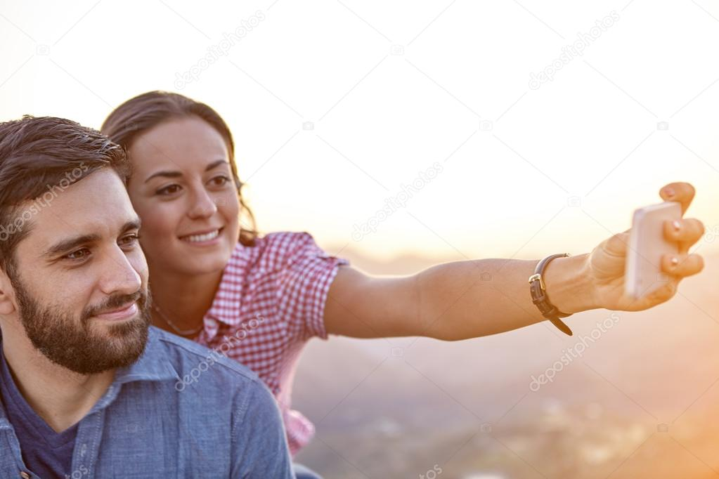Happy couple on mountain top