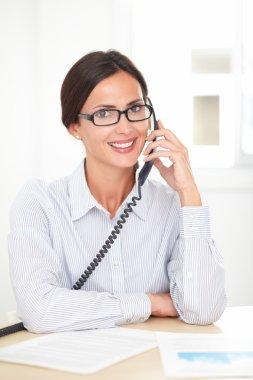Corporate secretary happily talking on the phone