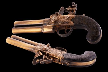 Two old pistols isolated in black