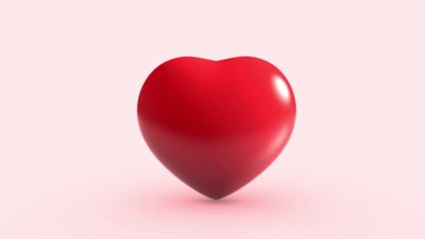 Srdce bije na růžovém pozadí. Jeden a jeden objekt. Valentýn a zdravotní koncept. Symbol lásky a náklonnosti. Grafické video s pohybem 4K. Bezešvé smyčky