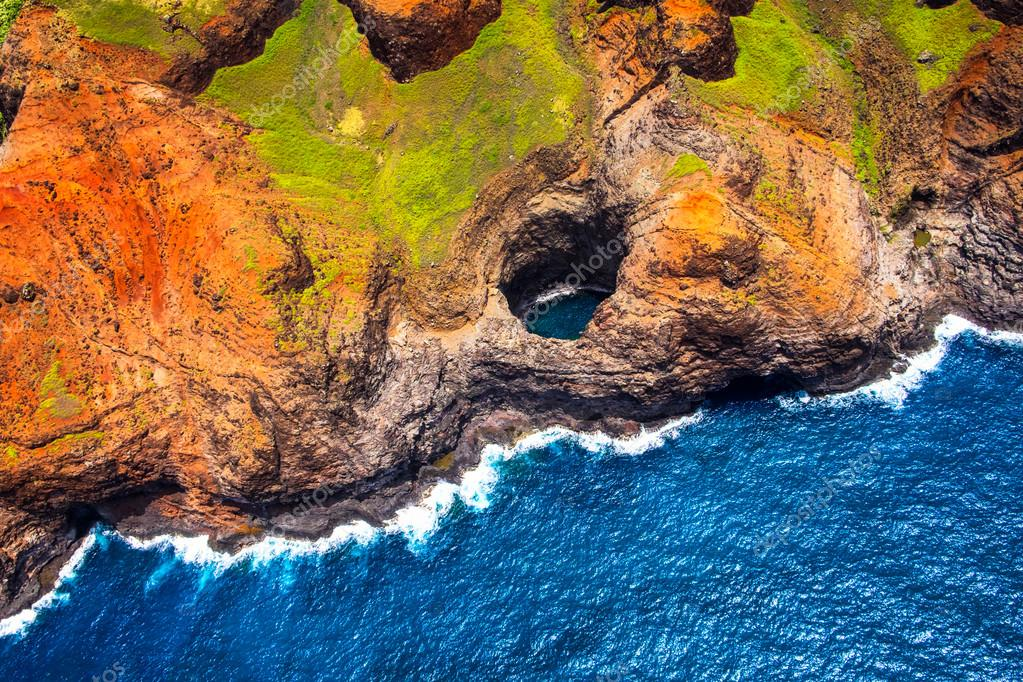 Aerial view of Na Pali coastline open ceiling cave from helicopt