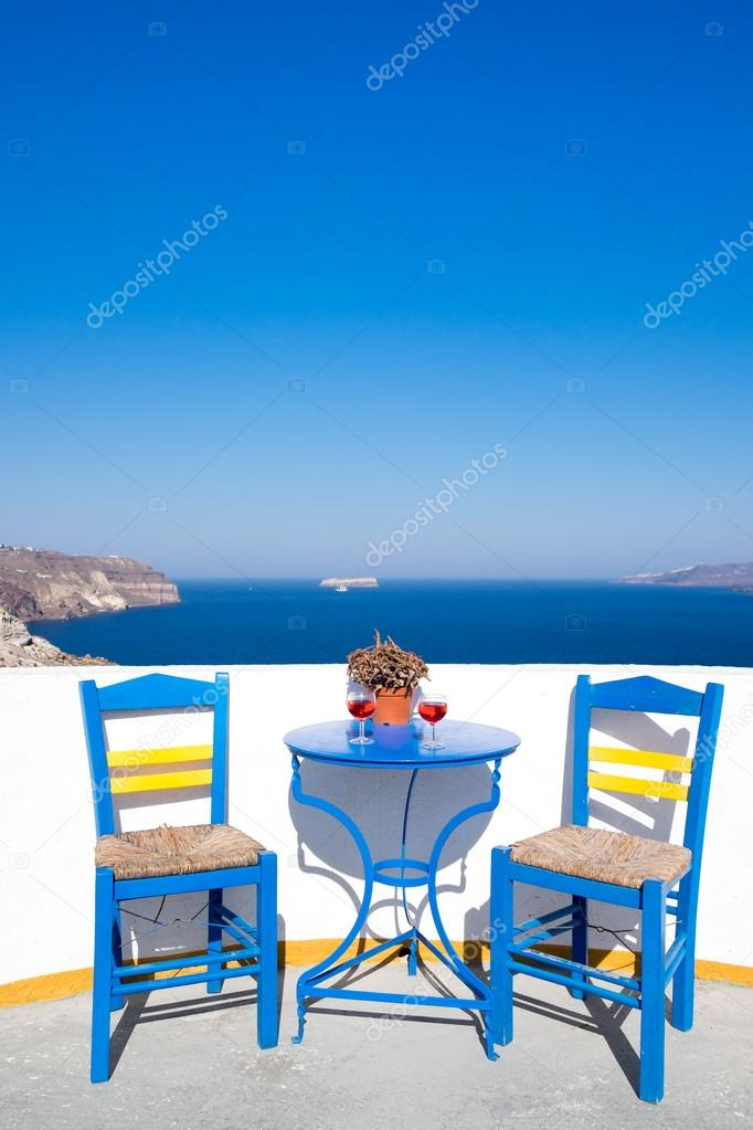 Blue Chairs And Table On A Mediterranean Balcony With Nice View To The Sea,  Santorini, Greece U2014 Photo By Martinm303