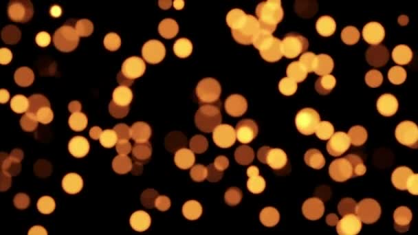 Golden defocused blurred particles
