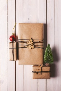 Christmas handcraft gift boxes on wood background.