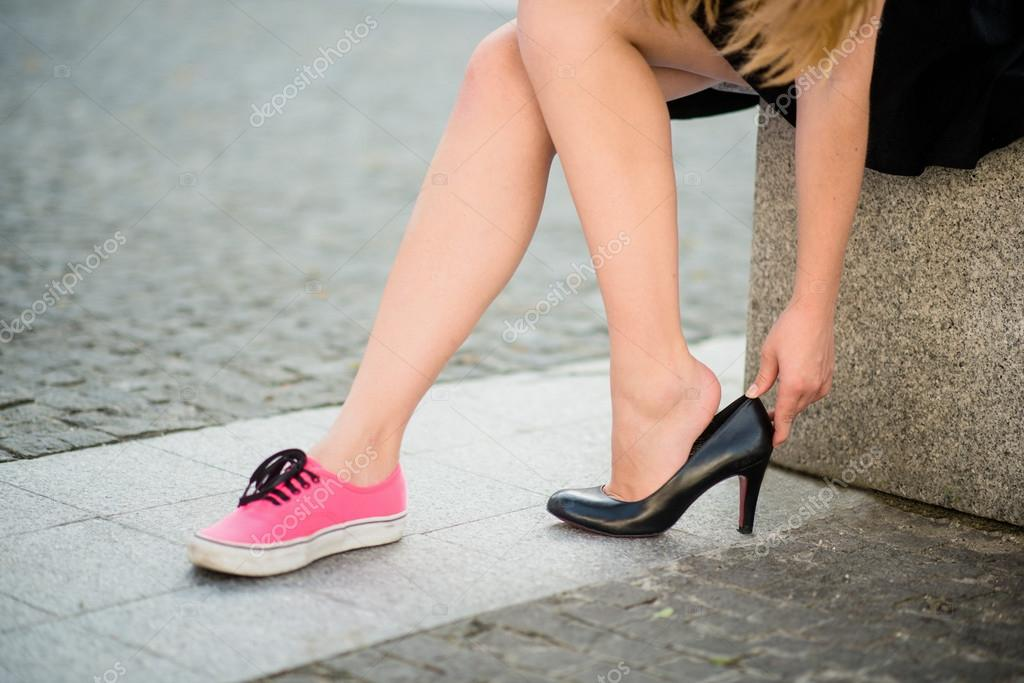 Man Trying On Womens Shoes