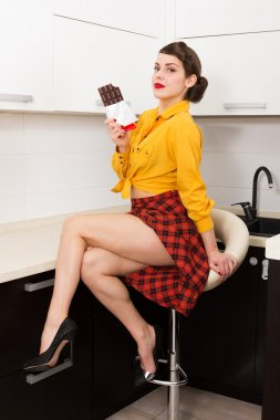 Beautiful woman with chocolate bar