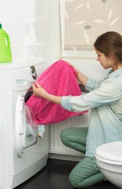 Beautiful girl doing laundry