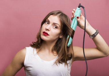 Woman styling her hair
