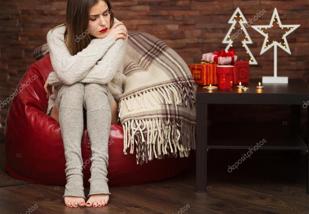 Sad woman with gift boxes