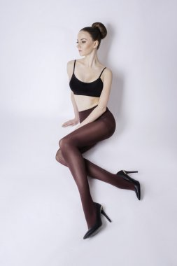 beautiful woman with long sexy legs in stockings