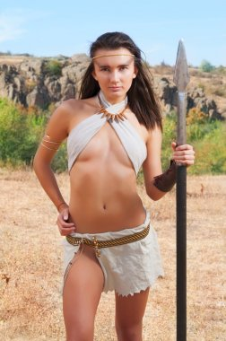 Primitive woman  holding a spear. Amazon woman