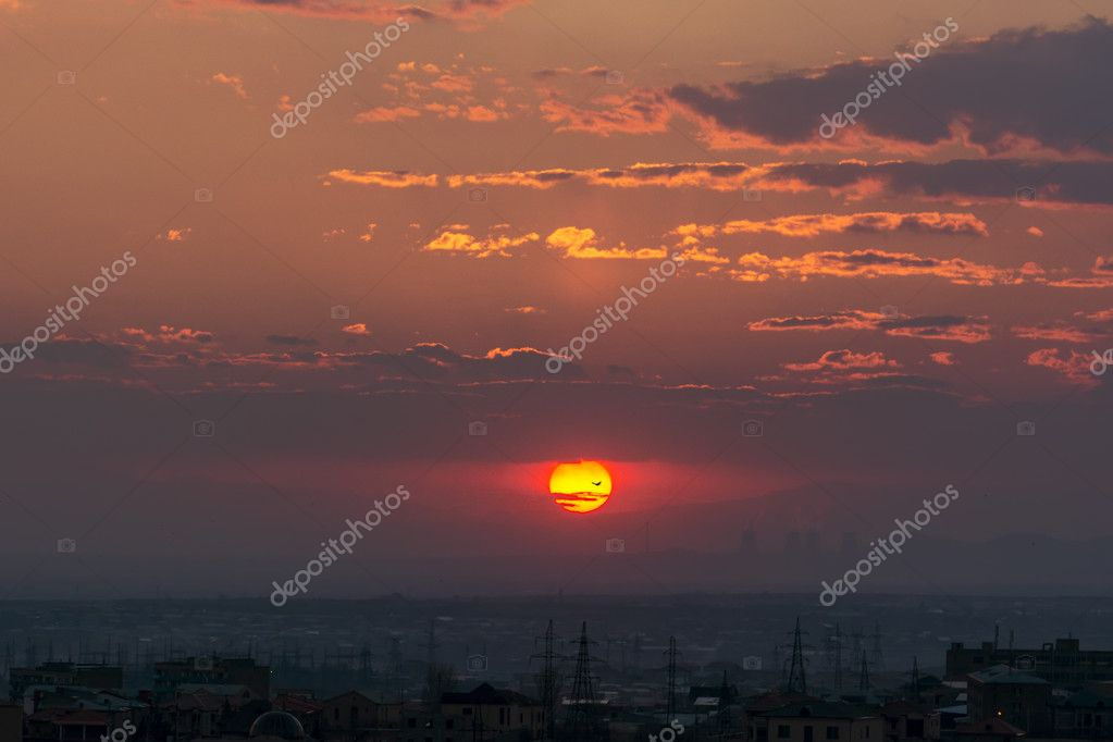 The Armenian Nuclear Power Plant and the sun, view from Yerevan, Armenia. Beautiful sunset