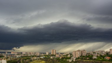 dramatic clouds and rain over city, Yerevan, Armenia
