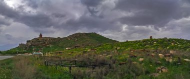Historic Armenian cemetry, graves, gravestones, at Khor Virap monastery, Dramatic sky, Armenia