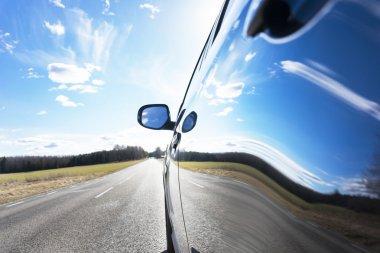 Sky reflected in car