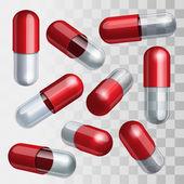 sada červených a transparentní lékařské kapsle v různých polohách