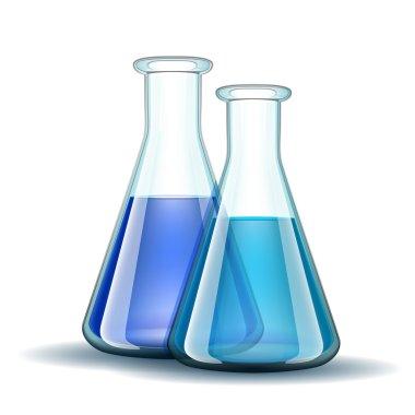 Chemical laboratory transparent flasks with blue liquid.