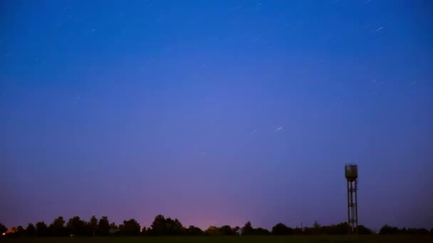 silhouettes of water tower in farmland. Night Starry Sky Galaxy natural background. time night. video night nighttime. Summer background, summertime background. Glowing Stars. Glow Of Sky Stars 4K