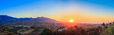 Mountain And Sunset at Mijas, Spain. Mountains on Yellow Sunrise