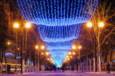 Festive Christmas New Year illuminations in city streets In Bela