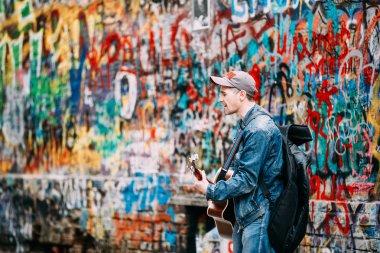 Man sings music band KINO songs near Viktor Tsoi Wall in Moscow, Russia