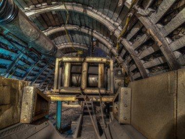 : A shearer l machine working  in a coal mine.