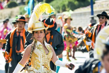 Cheerleader dancing with tipycal costume in carnival