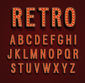 Fotografie Retro font with light bulbs.