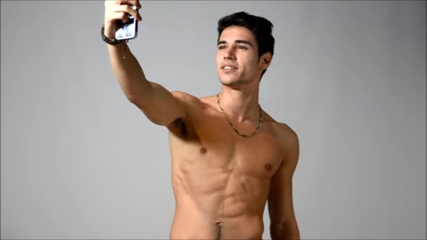 Shirtless young man taking selfie