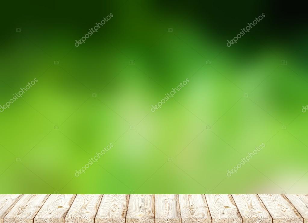 Light wood flooring to blur the background of high green grass or forest.