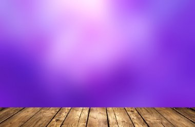 Violet purple blur the background. Wood flooring texture. The evening sky.