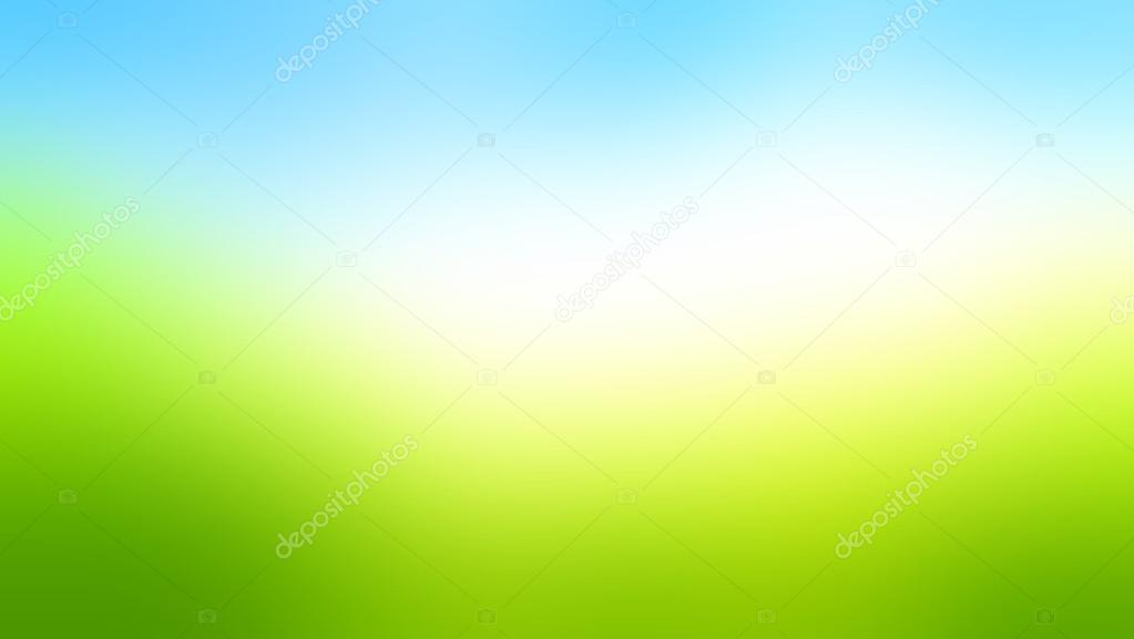 Wide bright field of summer. Blur the background. Bright sunlight and lush grass.