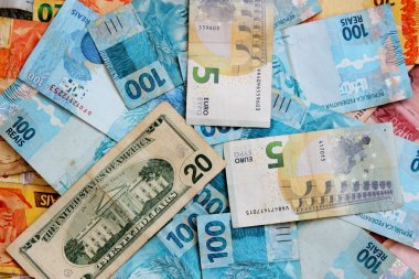 Money from different countries in close-up