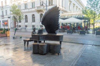 Lodz, Poland - June 7, 2021: Monument to Arthur Rubinstein, Polish American classical pianist on Piotrkowska street.