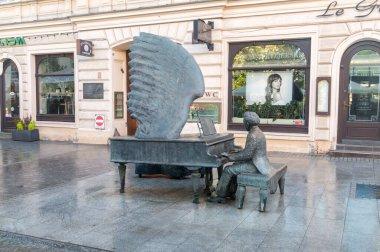 Lodz, Poland - June 7, 2021: Monument to Arthur Rubinstein (1887-1982), a Polish American classical pianist on Piotrkowska street.
