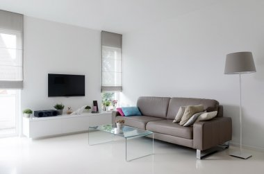 White living room with taupe sofa