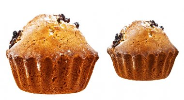 Two muffins with raisins on a white background