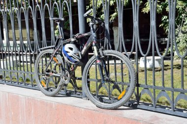 Moscow, Russia, August, 21,2016. Nobody, The bike is fastened to the fence with antigonos device